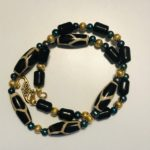 SOLD - Giraffe design beads & pearls with gold filled beads on clasp